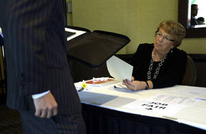 Photo -   FILE-In this Sept. 17, 2012, file photo, Patti Maurer of Pompano Beach, Fla., right, registers a job seeker at a job fair held by National Career Fairs, in Fort Lauderdale, Fla. A private survey relased Wednesday, Oct. 3, 2012, shows that U.S. businesses hired fewer workers in September than August, a sign that slow growth may be holding back hiring. Payroll processor ADP said Wednesday that companies added 162,000 jobs last month. That's below August's total of 189,000, which was revised lower. (AP Photo/Lynne Sladky, File)