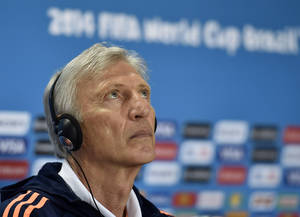 Photo - Colombia's head coach Jose Pekerman watches up during a press conference on the day before the group C World Cup soccer match between Colombia and Greece at the Mineirao Stadium in Belo Horizonte, Brazil, Friday, June 13, 2014.  (AP Photo/Martin Meissner)