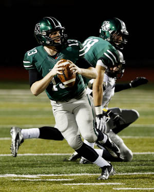 Photo - HIGH SCHOOL FOOTBALL PLAYOFFS: Timberwolf quarterback Peyton Gavras looks for a receiver as  Norman North plays Broken Arrow in Class 6A football on Friday, Nov. 16, 2012 in Norman, Okla.  Photo by Steve Sisney, The Oklahoman