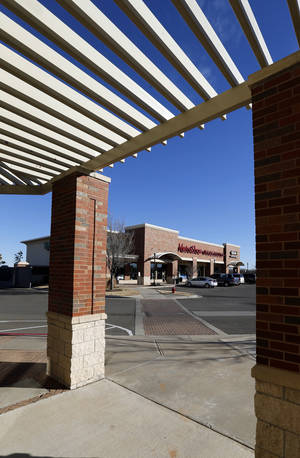 Photo - A pergola adds an architectural accent to University Town Center at Norman's University North Park, where retail spaces are being filled. <strong>STEVE SISNEY - THE OKLAHOMAN</strong>