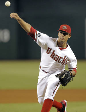 Photo - Arizona Diamondbacks pitcher Randall Delgado delivers against the San Francisco Giants during the first inning of a baseball game on Friday, Aug. 30, 2013, in Glendale, Ariz. (AP Photo/Matt York)