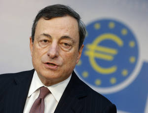 Photo - President of European Central Bank, ECB, Mario Draghi speaks during a news conference in Frankfurt, Germany, Thursday, June 6, 2013, following a meeting of the ECB governing council concerning the further strategies in the European financial crisis. Draghi said the economy of 17 European Union countries that use the euro would shrink 0.6 percent this year compared with the previous forecast of a 0.5 percent decline. (AP Photo/Michael Probst)