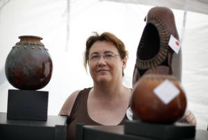 Photo - Brenda Dewald displays some of her gourd art at the Paseo Arts Festival.   Photos by Sarah Phipps, The Oklahoman