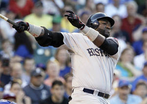 Photo -   Boston Red Sox's David Ortiz hits a one-run single against the Chicago Cubs during the first inning of an interleague baseball game in Chicago, Sunday, June 17, 2012. (AP Photo/Nam Y. Huh)