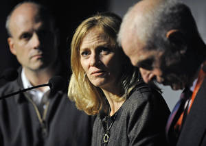 photo -   Mary Wittenberg, president of the New York Road Runners, speaks during a news conference Friday, Nov. 2, 2012, in New York, after New York Mayor Michael Bloomberg canceled Sunday's New York City Marathon. At left is Howard Wolfson, deputy mayor for government affairs and communication; at right is George Hirsch, chairman of the board of New York Road Runners. Bloomberg canceled the race after mounting criticism that this was not the time for a race, as the city continues to recover from Superstorm Sandy. (AP Photo/Louis Lanzano)