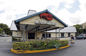 Photo - FILE - This Thursday, Sept. 6, 2012, file photo, shows a Red Lobster restaurant in Hialeah, Fla. Darden Restaurants on Friday, May 16, 2014 said it entered an agreement to sell its Red Lobster chain to investment firm Golden Gate Capital in a $2.1 billion cash deal. (AP Photo/Alan Diaz, File)