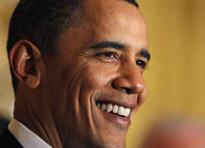 Photo - President Barack Obama smiles as he speaks during a St. Patrick's Day reception in the East Room of the White House in Washington, Wednesday, March 17, 2010.(AP Photo/Alex Brandon)