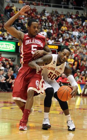 Photo - Oklahoma guard Je'lon Hornbeak (5) runs into Iowa State guard DeAndre Kane (50) during the first half of an NCAA college basketball game in Ames, Iowa, Saturday, Feb. 1, 2014. (AP Photo/Justin Hayworth)