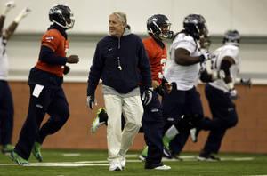 Photo - Seattle Seahawks head coach Pete Carroll watches as members of his team warms up during NFL football practice Thursday, Jan. 30, 2014, in East Rutherford, N.J. The Seahawks and the Denver Broncos are scheduled to play in the Super Bowl XLVIII football game Sunday, Feb. 2, 2014. (AP Photo)