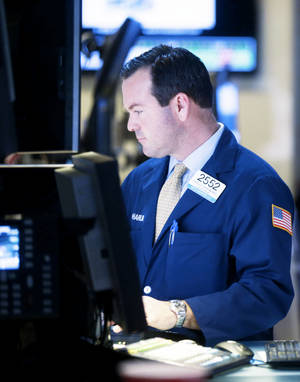 photo - A trader works on the floor at the New York Stock Exchange on Wednesday in New York. AP Photo