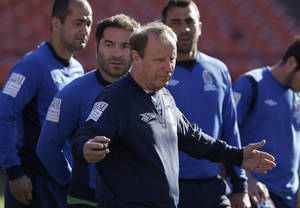 Photo - Azerbaijan soccer head coach Berti Vogts, center, gathers his team together before practice at Candlestick Park in San Francisco, Sunday, May 25, 2014. (AP Photo/Jeff Chiu)