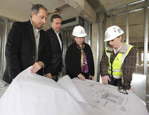 Photo - Paul Coury, left, Jeff Erwin, Catherine Montgomery, and Andrea Gossard discuss renovations underway at the Osler Building at 1200 N. Walker in Oklahoma City, OK, Thursday, March 21, 2013,  By Paul Hellstern, The Oklahoman