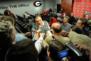 Photo - Georgia defensive coordinator Todd Grantham speaks with the media during a national signing day news conference in Athens, Ga., Wednesday, Feb. 6, 2013. (AP Photo/The Athens Banner-Herald, AJ Reynolds)   MAGS OUT; MANDATORY CREDIT