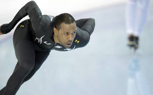 Photo - Speedskater Shani Davis of the U.S. trains at the Adler Arena Skating Center during the 2014 Winter Olympics in Sochi, Russia, Thursday, Feb. 6, 2014. (AP Photo/Patrick Semansky)