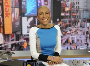 "Photo - This Jan. 24, 2013 photo released by ABC shows Robin Roberts on ""Good Morning America,"" in New York. Roberts will be back on the job at the ""Good Morning America"" anchor desk on Feb. 20. Her return will be five months to the day since her bone marrow transplant to treat a rare blood disorder. (AP Photo/ABC, Ida Mae Astute)"
