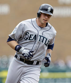 Photo -   Seattle Mariners' Justin Smoak rounds third base after hitting a three-run home run against the Detroit Tigers in the first inning of a baseball game in Detroit, Thursday, April 26, 2012. (AP Photo/Paul Sancya)