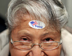 "photo -   Dora A Winter of Nampa, looks up after an ""I Voted"" sticker was placed on her forehead at Karcher Church of the Nazarene on Election Day, Tuesday, Nov. 6, 2012 in Nampa, Idaho. After a grinding presidential campaign President Barack Obama and Republican presidential candidate, former Massachusetts Gov. Mitt Romney, yield center stage to American voters Tuesday for an Election Day choice that will frame the contours of government and the nation for years to come. (AP Photo/Idaho Press-Tribune, Adam Eschbach) MANDATORY CREDIT: ADAM ESCHBACH/IDAHO PRESS-TRIBUNE"