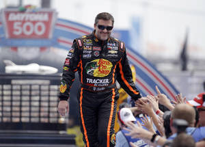 Photo - Driver Tony Stewart greets fans as he is introduced before the NASCAR Daytona 500 Sprint Cup series auto race at Daytona International Speedway in Daytona Beach, Fla., Sunday, Feb. 23, 2014. (AP Photo/John Raoux)
