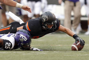 photo - Oklahoma State&#039;s Austin Hays (84) recovers a fumble in front of Kevin White (25) during a college football game between Oklahoma State University (OSU) and Texas Christian University (TCU) at Boone Pickens Stadium in Stillwater, Okla., Saturday, Oct. 27, 2012. Photo by Sarah Phipps, The Oklahoman
