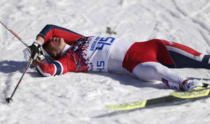 Photo - Norway's Marit Bjoergen catches her breath after the women's 10K classical-style cross-country race at the 2014 Winter Olympics, Thursday, Feb. 13, 2014, in Krasnaya Polyana, Russia. (AP Photo/Matthias Schrader)