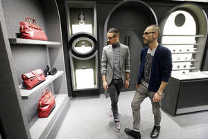 Photo - Netherlands' fashion designers Rolf Snoeren, left, and Viktor Horstingllok in their new Viktor and Rolf shop in Paris, Wednesday, Dec. 11, 2013. Viktor&Rolf, the Amsterdam-based avant-garde fashion house, opens its first ever flagship boutique in France in Paris. (AP Photo/Francois Mori)