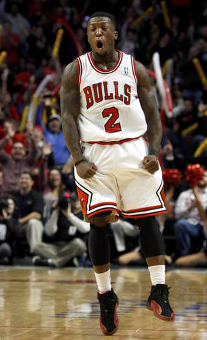 Photo - Chicago Bulls point guard Nate Robinson reacts during the second half of an NBA basketball game against the Detroit Pistons, Wednesday, Jan. 23, 2013, in Chicago. The Bulls won 85-82. (AP Photo/Charles Rex Arbogast)