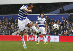 photo - Queens Park Rangers' Andros Townsend shoots to score against Sunderland during their English Premier League soccer match at Loftus Road stadium, London, Saturday, March 9, 2013. (AP Photo/Sang Tan)