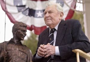 "Photo -   FILE - This Oct. 28, 2003 file photo shows actor Andy Griffith sitting in front of a bronze statue of Andy and Opie from the ""Andy Griffith Show,"" after the unveiling ceremony in Raleigh, N.C. Griffith, whose homespun mix of humor and wisdom made ""The Andy Griffith Show"" an enduring TV favorite, died Tuesday, July 3, 2012 in Manteo, N.C. He was 86. (AP Photo/Bob Jordan, File)"