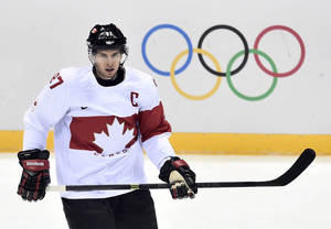 Photo - Canada's Sidney Crosby takes part in a warm-up ahead of quarterfinal hockey action against Latvia at the 2014 Sochi Winter Olympics in Sochi, Russia on Wednesday, Feb. 19, 2014. (AP Photo/The Canadian Press, Nathan Denette)