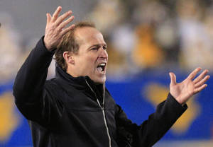 photo - West Virginia coach Dana Holgorsen reacts to a call during the third quarter of their NCAA college football game against Oklahoma in Morgantown, W.Va., on Saturday, Nov. 17, 2012. Oklahoma won 50-49. (AP Photo/Christopher Jackson) ORG XMIT: WVCJ117