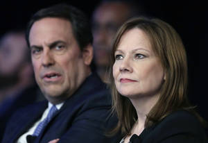 Photo - FILE - In this April 15, 2014 file photo, Mary Barra, CEO of General Motors, right, and Mark Reuss, Executive Vice President of Global Product Development for GM and President of GM America, watch the introduction of new Chevrolet cars at the New York International Auto Show, in New York. GM's corporate structure _ as well as what Barra has called a culture that valued cost-savings over safety _ will likely be a prime target in a report expected this week from former U.S. Attorney Anton Valukas. (AP Photo/Mark Lennihan, File)