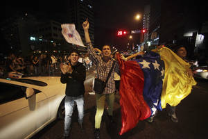 Photo -   Supporters of former opposition presidential candidate Henrique Capriles wave a Venezuelan flag during a protest accusing Venezuela's re-elect President Hugo Chavez of electoral fraud in Caracas, Venezuela, Monday, Oct. 8, 2012. (AP Photo/Fernando Llano)
