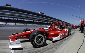 Photo - In this photo taken with a fisheye lens, Scott Dixon, of New Zealand, pulls out of the pit area during practice for the Indianapolis 500 auto race at the Indianapolis Motor Speedway in Indianapolis, Monday, May 13, 2013. (AP Photo/Darron Cummings)