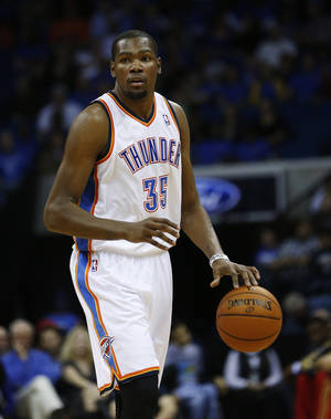 Photo - Most NBA general managers would like Kevin Durant shooting with the game on the line.  AP photo
