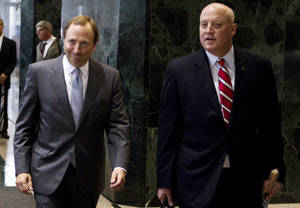 photo - FILE - This Aug. 14, 2012, file photo shows NHL commissioner Gary Bettman, left, and Bill Daly, deputy commissioner and chief legal officer, following collective bargaining talks in Toronto. The NHL is set to get back to the bargaining table Sunday, Dec. 30, 2012, with the locked-out players association after a new contract offer from the league broke the ice between the fighting sides. &quot;We delivered to the union a new, comprehensive proposal for a successor CBA,&quot; NHL deputy commissioner Bill Daly said in a statement Friday, Dec. 28. &quot;We are not prepared to discuss the details of our proposal at this time.&quot; (AP Photo/The Canadian Press, Chris Young, File)