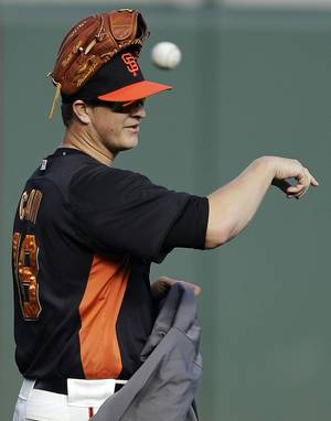 photo -   San Francisco Giants pitcher Matt Cain prepares for batting practice in preparation for Game 1 of the National League division baseball series against the Cincinnati Reds, Thursday, Oct. 4, 2012, in San Francisco. Cain will be the Giants starting pitcher in Game 1. (AP Photo/Ben Margot)