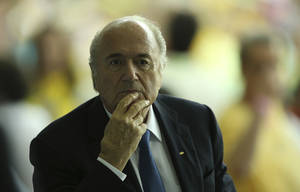 Photo - FIFA President Joseph Blatter arrives for the soccer Confederations Cup final between Brazil and Spain at the Maracana stadium in Rio de Janeiro, Brazil, Sunday, June 30, 2013. (AP Photo/Eugene Hoshiko)
