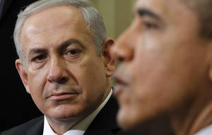 photo -   FILE - In this Monday, March 5, 2012 file photo, Israeli Prime Minister Benjamin Netanyahu listens as President Barack Obama speaks during their meeting in the Oval Office of the White House in Washington. President Barack Obama's re-election leaves Israel's prime minister in a bind. Benjamin Netanyahu has clashed with Obama and was widely seen as backing challenger Mitt Romney. In coming months, however, Netanyahu will need American support as the Palestinians seek upgraded U.N. recognition and the world grapples with Iran's nuclear program. (AP Photo/Pablo Martinez Monsivais, File)