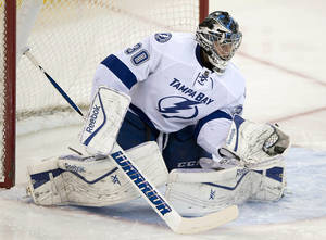 Photo - Tampa Bay Lightning goalie Ben Bishop makes a save against the Ottawa Senators during the first period of an NHL hockey game Thursday, March 20, 2014, in Ottawa. (AP Photo/The Canadian Press, Adrian Wyld)