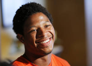 Photo - OSU's Josh Stewart smiles while answering a question during Oklahoma State University football media availability at Boone Pickens Stadium in Stillwater, Okla., Thursday, Aug. 23, 2012. Photo by Nate Billings, The Oklahoman