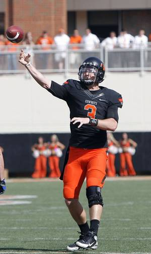Photo - Oklahoma State's Brandon Weeden (3) throws a pass during the first half of the college football game between the Oklahoma State University Cowboys (OSU) and the University of Kansas Jayhawks (KU) at Boone Pickens Stadium in Stillwater, Okla., Saturday, Oct. 8, 2011. Photo by Sarah Phipps, The Oklahoman