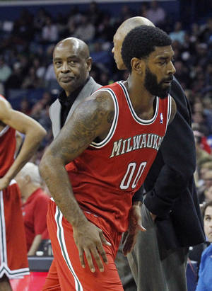 Photo - Milwaukee Bucks shooting guard O.J. Mayo (00) leaves the game after being ejected for a flagrant foul in the first half of an NBA basketball game against the New Orleans Pelicans in New Orleans, Friday, March 7, 2014. Bucks coach Larry Drew watches Mayo leave the court. (AP Photo/Bill Haber)