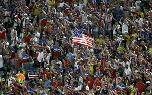Photo - Fans wave a United States' flag during the group G World Cup soccer match between Ghana and the United States at the Arena das Dunas in Natal, Brazil, Monday, June 16, 2014. (AP Photo/Hassan Ammar)