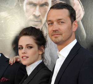 "Photo -   FILE - This May 29, 2012 file photo shows actress Kristen Stewart and director Rupert Sanders attending the ""Snow White and the Huntsman"" screening in Los Angeles. Stewart and director Rupert Sanders are apologizing publicly to their loved ones following reports of infidelity. The 22-year-old actress and the 41-year-old filmmaker issued separate apologies to People magazine Wednesday, July 25, saying they regret the hurt they have caused. Stewart has been in a relationship for several years with her ""Twilight"" co-star Robert Pattinson. Sanders is married and has two children. (Photo by Jordan Strauss/Invision/AP)"
