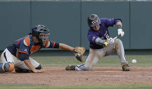 Photo - CORRECTS NAME OF CATCHER - Pepperdine catcherAaron Barnett, left, reaches for the ball as TCU's Kyle Bacak (6) makes contact for a sacrifice bunt to score teammate Jerrick Suiter, on what would be the game winning run, during the ninth inning of an NCAA college baseball tournament super regional game in Fort Worth, Texas, Monday, June 9, 2014. (AP Photo/Brandon Wade)
