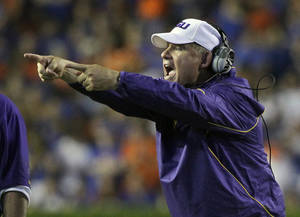 Photo - LSU coach Les Miles has had some late-game adventures. AP photo