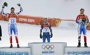 Photo - Men's giant slalom medalists, from left, France's Steve Missillier (silver), United States' Ted Ligety (gold) and France's Alexis Pinturault (bronze) take part in a flower ceremony at at the Sochi 2014 Winter Olympics, Wednesday, Feb. 19, 2014, in Krasnaya Polyana, Russia.(AP Photo/Christophe Ena)
