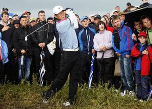 Photo - Anthony Kim of the US plays a shot off the 14th tee during the final day of the  British Open Golf Championship at Royal St George's golf course Sandwich, England, Sunday, July 17, 2011. (AP Photo/Jon Super) ORG XMIT: XSDW318 <strong>Jon Super - AP</strong>
