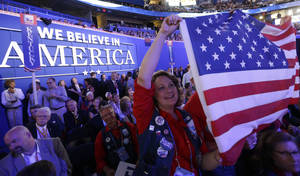 Photo - Montana delegate Karen Pfaehler holds up an American flag during the Republican National Convention in Tampa, Fla., on Thursday, Aug. 30, 2012. (AP Photo/David Goldman)  ORG XMIT: RNC752
