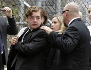 "Photo - FILE - In this Thursday, June 27, 2013 file photo, Michael Gandolfini, left, son of James Gandolfini, arrives for the funeral service of his father, star of ""The Sopranos,"" in New York's the Cathedral Church of Saint John the Divine. James Gandolfini left the bulk of his estimated $70 million estate to his 13-year-old son, Michael, and infant daughter Liliana. (AP Photo/Richard Drew, File)"